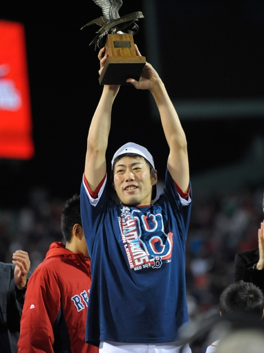 Oct 19, 2013; Boston, MA, USA; Boston Red Sox relief pitcher Koji Uehara (19) holds his MVP trophy after defeating the Detroit Tigers in game six of the American League Championship Series baseball game at Fenway Park. Mandatory Credit: Bob DeChiara-USA TODAY Sports