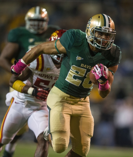 Oct 19, 2013; Waco, TX, USA; Baylor Bears running back Devin Chafin (28) runs for a touchdown during the game against the Iowa State Cyclones at Floyd Casey Stadium. The Bears defeated the Cyclones 71-7. Mandatory Credit: Jerome Miron-USA TODAY Sports