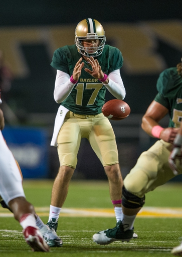 Oct 19, 2013; Waco, TX, USA; Baylor Bears quarterback Seth Russell (17) takes the snap during the game against the Iowa State Cyclones at Floyd Casey Stadium. The Bears defeated the Cyclones 71-7. Mandatory Credit: Jerome Miron-USA TODAY Sports