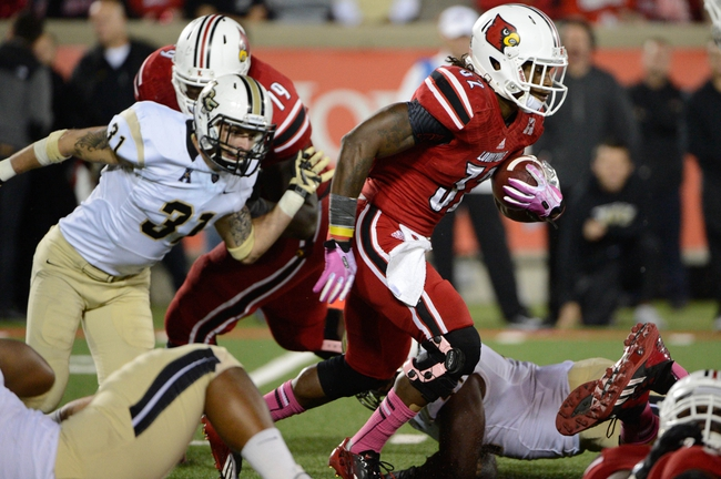 Oct 18, 2013; Louisville, KY, USA; Louisville Cardinals running back Senorise Perry (32) runs the ball against the UCF Knights during the second half of play at Papa John's Cardinal Stadium. Central Florida defeated Louisville 38-35.  Mandatory Credit: Jamie Rhodes-USA TODAY Sports