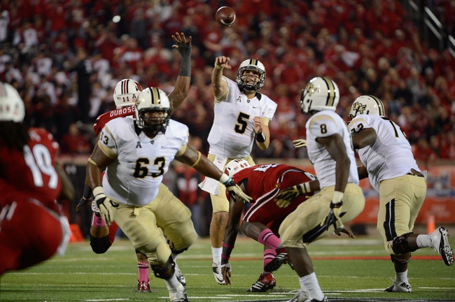Oct 18, 2013; Louisville, KY, USA; UCF Knights quarterback Blake Bortles (5) throws a pass to UCF Knights running back Storm Johnson (8) during the second half of play against the Louisville Cardinals at Papa John's Cardinal Stadium. Central Florida defeated Louisville 38-35.  Mandatory Credit: Jamie Rhodes-USA TODAY Sports