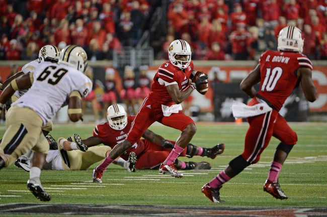 Oct 18, 2013; Louisville, KY, USA; Louisville Cardinals quarterback Teddy Bridgewater (5) scrabbles with the ball during the second half of play against the UCF Knights at Papa John's Cardinal Stadium. Central Florida defeated Louisville 38-35.  Mandatory Credit: Jamie Rhodes-USA TODAY Sports