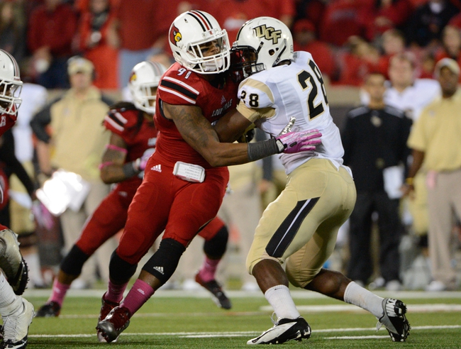 Oct 18, 2013; Louisville, KY, USA; Louisville Cardinals defensive end Marcus Smith (91) battles past the block of UCF Knights running back William Stanback (28) during the second half of play at Papa John's Cardinal Stadium. Central Florida defeated Louisville 38-35.  Mandatory Credit: Jamie Rhodes-USA TODAY Sports