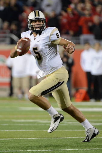 Oct 18, 2013; Louisville, KY, USA; UCF Knights quarterback Blake Bortles (5) scrambles with the ball during the second half of play against the Louisville Cardinals at Papa John's Cardinal Stadium. Central Florida defeated Louisville 38-35.  Mandatory Credit: Jamie Rhodes-USA TODAY Sports