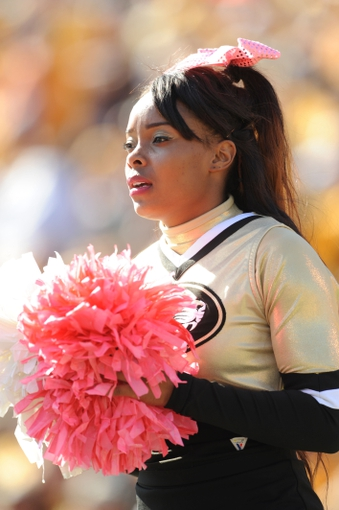 Oct 19, 2013; Columbia, MO, USA; Missouri Tigers cheerleaders perform for the crowd during the second half of the game against the Florida Gators at Faurot Field. Missouri won 36-17. Mandatory Credit: Denny Medley-USA TODAY Sports