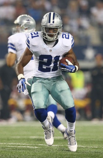 Oct 13, 2013; Arlington, TX, USA; Dallas Cowboys running back Joseph Randle (21) runs with the ball against the Washington Redskins at AT&T Stadium. Mandatory Credit: Matthew Emmons-USA TODAY Sports