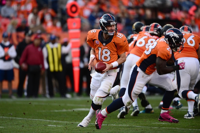 Oct 13, 2013; Denver, CO, USA; Denver Broncos quarterback Peyton Manning (18) during a play action set in the third quarter against the Jacksonville Jaguars at Sports Authority Field at Mile High. The Broncos defeated the Jaguars 35-19. Mandatory Credit: Ron Chenoy-USA TODAY Sports