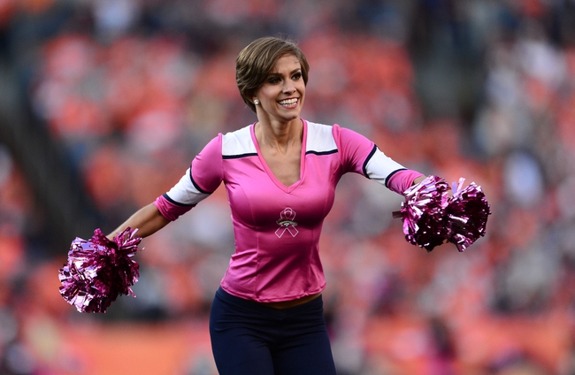 Oct 13, 2013; Denver, CO, USA; Denver Broncos cheerleader performs in the third quarter against the Jacksonville Jaguars at Sports Authority Field at Mile High. The Broncos defeated the Jaguars 35-19. Mandatory Credit: Ron Chenoy-USA TODAY Sports