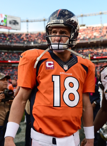 Oct 13, 2013; Denver, CO, USA; Denver Broncos quarterback Peyton Manning (18) following the game against the Jacksonville Jaguars at Sports Authority Field at Mile High. The Broncos defeated the Jaguars 35-19. Mandatory Credit: Ron Chenoy-USA TODAY Sport