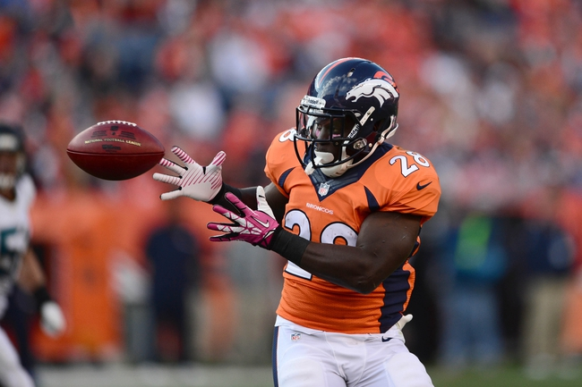 Oct 13, 2013; Denver, CO, USA; Denver Broncos running back Montee Ball (28) catches a pass in the third quarter against the Jacksonville Jaguars at Sports Authority Field at Mile High. The Broncos defeated the Jaguars 35-19. Mandatory Credit: Ron Chenoy-USA TODAY Sports
