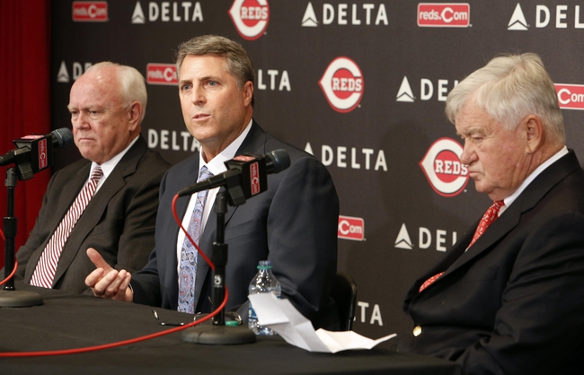 Oct 22, 2013; Cincinnati, OH, USA; Cincinnati Reds new manager Bryan Price (middle) speaks with general manager Walt Jocketty (left) and president Bob Castellini during a news conference at Great American Ballpark. Mandatory Credit: David Kohl-USA TODAY Sports