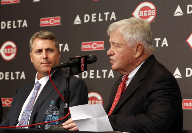 Oct 22, 2013; Cincinnati, OH, USA; Cincinnati Reds president Bob Castellini (right) speaks during the announcement naming Bryan Price (left) new manager of the Cincinnati Reds at Great American Ballpark. Mandatory Credit: David Kohl-USA TODAY Sports