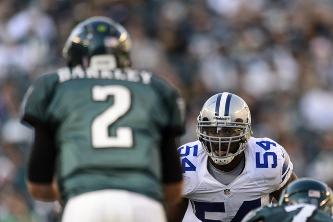 Oct 20, 2013; Philadelphia, PA, USA; Dallas Cowboys linebacker Bruce Carter (54) watches Philadelphia Eagles quarterback Matt Barkley (2) during the fourth quarter at Lincoln Financial Field. The Cowboys defeated the Eagles 17-3. Mandatory Credit: Howard Smith-USA TODAY Sports