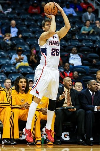 Oct 22, 2013; Atlanta, GA, USA; Atlanta Hawks shooting guard Kyle Korver (26) shoots a three in the first half against the Indiana Pacers at Philips Arena. Mandatory Credit: Daniel Shirey-USA TODAY Sports