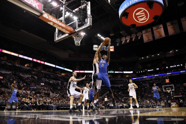 Oct 22, 2013; San Antonio, TX, USA; Orlando Magic forward Maurice Harkless (21) drives to the basket as San Antonio Spurs forward Boris Diaw (behind) defends during the first half at AT&T Center. Mandatory Credit: Soobum Im-USA TODAY Sports