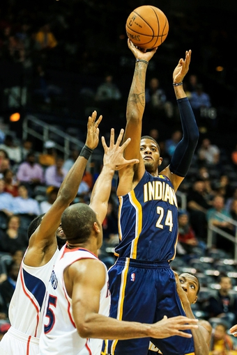Oct 22, 2013; Atlanta, GA, USA; Indiana Pacers shooting guard Paul George (24) shoots a basket in the second half against the Atlanta Hawks at Philips Arena. The Pacers won 107-89. Mandatory Credit: Daniel Shirey-USA TODAY Sports