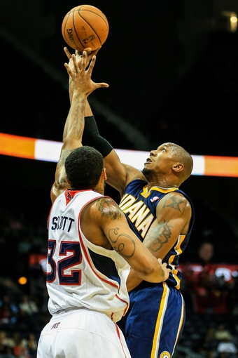 Oct 22, 2013; Atlanta, GA, USA; Indiana Pacers power forward David West (21) shoots a basket over Atlanta Hawks power forward Mike Scott (32) in the second half at Philips Arena. The Pacers won 107-89. Mandatory Credit: Daniel Shirey-USA TODAY Sports