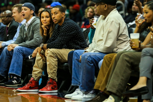 Oct 22, 2013; Atlanta, GA, USA; Rapper Ludacris watches the game between the Indiana Pacers and the Atlanta Hawks at Philips Arena. The Pacers won 107-89. Mandatory Credit: Daniel Shirey-USA TODAY Sports