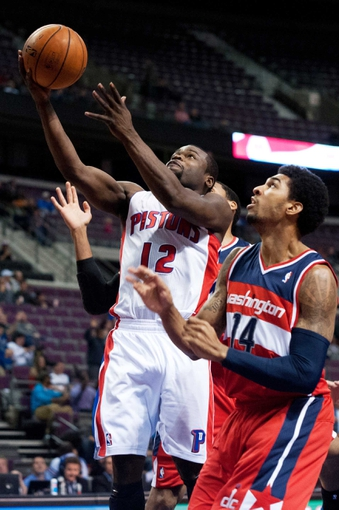 Oct 22, 2013; Auburn Hills, MI, USA; Detroit Pistons point guard Will Bynum (12) drives to the basket against Washington Wizards point guard Glen Rice Jr. (14) during the fourth quarter at The Palace of Auburn Hills. Pistons won 99-96. Mandatory Credit: Tim Fuller-USA TODAY Sports