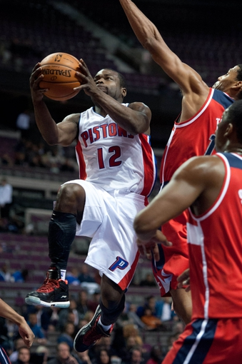 Oct 22, 2013; Auburn Hills, MI, USA; Detroit Pistons point guard Will Bynum (12) drives to the basket during the fourth quarter against the Washington Wizards at The Palace of Auburn Hills. Pistons won 99-96. Mandatory Credit: Tim Fuller-USA TODAY Sports