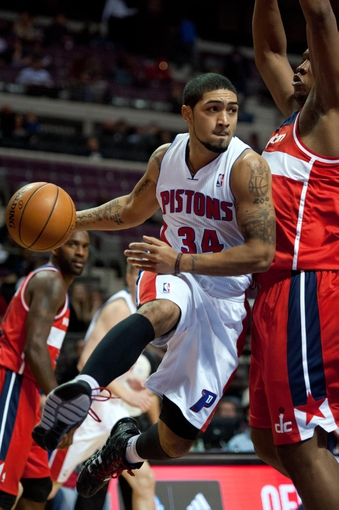 Oct 22, 2013; Auburn Hills, MI, USA; Detroit Pistons point guard Peyton Siva (34) drives to the basket against the Washington Wizards during the game at The Palace of Auburn Hills. Pistons won 99-96. Mandatory Credit: Tim Fuller-USA TODAY Sports