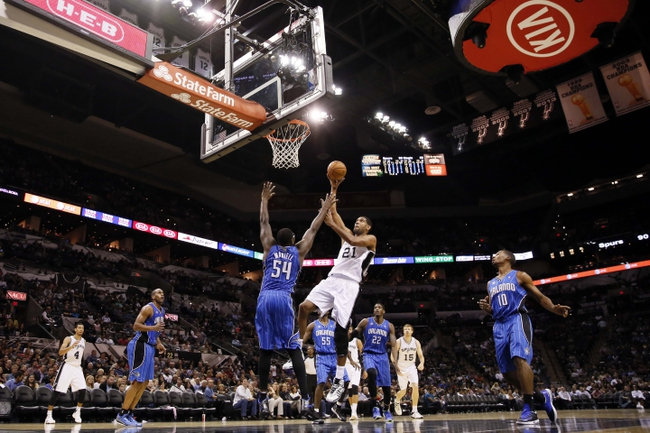 Oct 22, 2013; San Antonio, TX, USA; San Antonio Spurs forward Tim Duncan (21) drives to the basket while guarded by Orlando Magic forward Jason Maxiell (54) during the second half at AT&T Center. The Spurs won 123-101. Mandatory Credit: Soobum Im-USA TODAY Sports