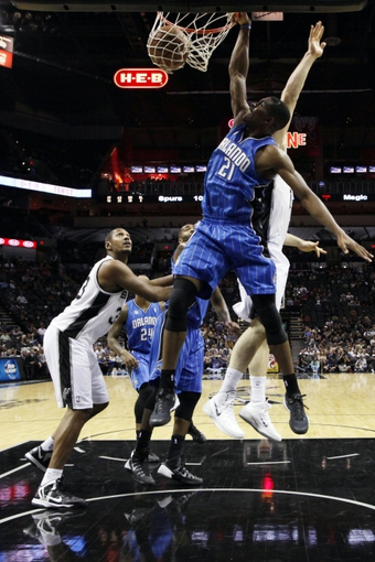 Oct 22, 2013; San Antonio, TX, USA; Orlando Magic forward Maurice Harkless (21) dunks past San Antonio Spurs forward Aron Baynes (behind) during the second half at AT&T Center. The Spurs won 123-101. Mandatory Credit: Soobum Im-USA TODAY Sports