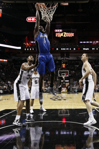 Oct 22, 2013; San Antonio, TX, USA; Orlando Magic guard Victor Oladipo (5) dunks against the San Antonio Spurs during the second half at AT&T Center. The Spurs won 123-101. Mandatory Credit: Soobum Im-USA TODAY Sports