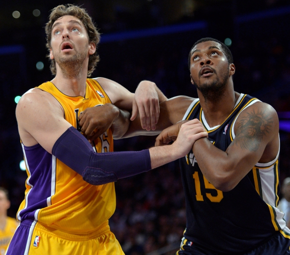 Oct 22, 2013; Los Angeles, CA, USA;  Los Angeles Lakers power forward Pau Gasol (16) and Utah Jazz power forward Derrick Favors (15) battle for rebounding position under the basket during second quarter action at Staples Center. Mandatory Credit: Robert Hanashiro-USA TODAY Sports