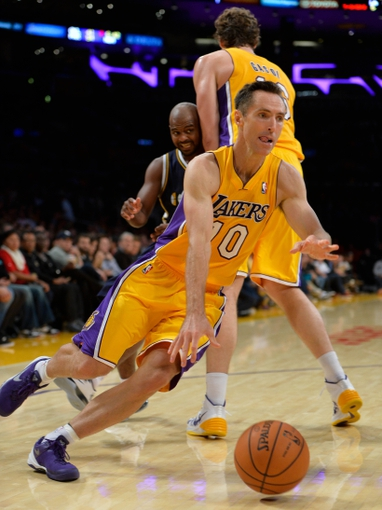 Oct 22, 2013; Los Angeles, CA, USA; Los Angeles Lakers point guard Steve Nash (10) drives around a pick set by teammate Los Angeles Lakers power forward Pau Gasol (16) on Utah Jazz point guard John Lucas III (5) during second quarter action at Staples Center. Mandatory Credit: Robert Hanashiro-USA TODAY Sports