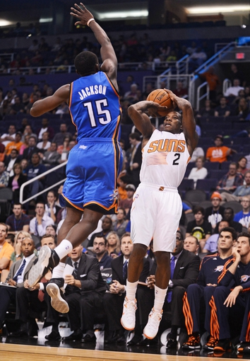 Oct 22, 2013; Phoenix, AZ, USA;Phoenix Suns guard Eric Bledsoe (2) puts up a shot against the Oklahoma City Thunder guard Reggie Jackson (15) in the second half at US Airways Center. The Suns defeated the Thunder 88 to 76. Mandatory Credit: Jennifer Stewart-USA TODAY Sports