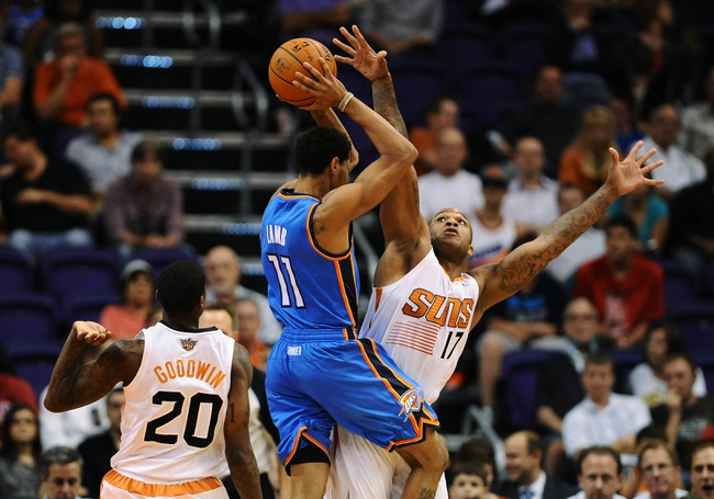 Oct 22, 2013; Phoenix, AZ, USA;Phoenix Suns forward P.J Tucker (17) guards the Oklahoma City Thunder guard Jeremy Lamb (11) in the second half at US Airways Center. The Suns defeated the Thunder 88 to 76. Mandatory Credit: Jennifer Stewart-USA TODAY Sports
