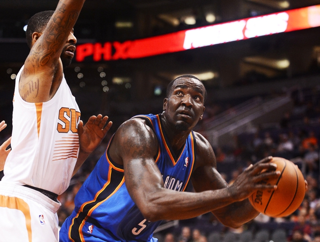 Oct 22, 2013; Phoenix, AZ, USA; Oklahoma City Thunder center Kendrick Perkins (5) handles the ball against the Phoenix Suns forward Markieff Morris (11) in the first half at US Airways Center. The Suns defeated the Thunder 88 to 76. Mandatory Credit: Jennifer Stewart-USA TODAY Sports