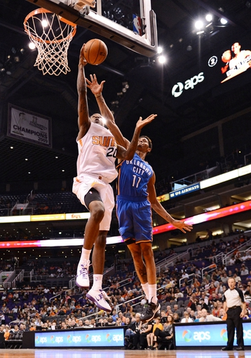 Oct 22, 2013; Phoenix, AZ, USA;Phoenix Suns guard Archie Goodwin (20) lays up the ball against the Oklahoma City Thunder guard Jeremy Lamb (11) in the second half at US Airways Center. The Suns defeated the Thunder 88 to 76. Mandatory Credit: Jennifer Stewart-USA TODAY Sports