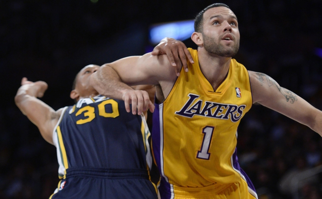 Oct 22, 2013; Los Angeles, CA, USA;  Utah Jazz point guard Scott Machado (30) gets an elbow to the face from Los Angeles Lakers point guard Jordan Farmar (1) during second half action at Staples Center. Mandatory Credit: Robert Hanashiro-USA TODAY Sports