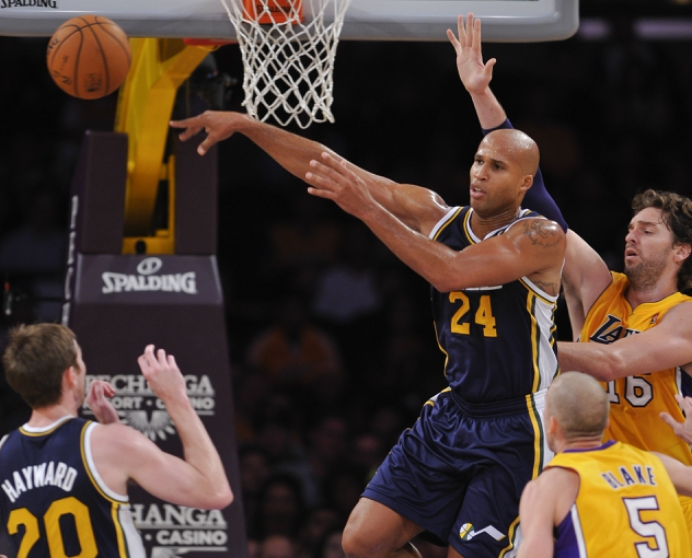 Oct 22, 2013; Los Angeles, CA, USA;  Utah Jazz small forward Richard Jefferson (24) hangs in the air as he passes off to a teammate in front of Los Angeles Lakers power forward Pau Gasol (16) and Los Angeles Lakers point guard Steve Blake (5) during first half action at Staples Center. Mandatory Credit: Robert Hanashiro-USA TODAY Sports