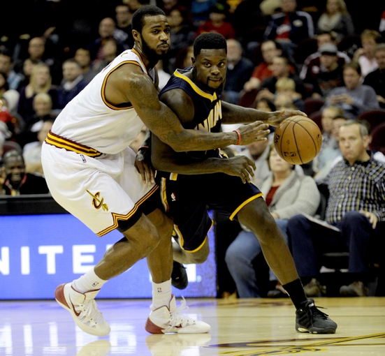 Oct 19, 2013; Cleveland, OH, USA; Indiana Pacers guard Lance Stephenson (1) and Cleveland Cavaliers forward Earl Clark (6) during the game at Quicken Loans Arena. The Pacers beat the Cavaliers 102-79. Mandatory Credit: Ken Blaze-USA TODAY Sports