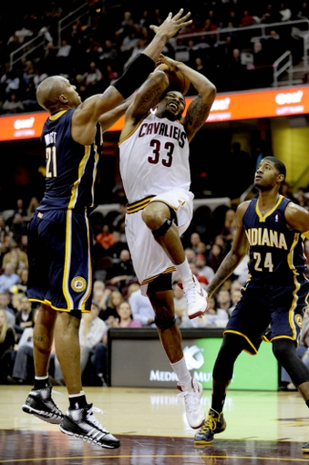 Oct 19, 2013; Cleveland, OH, USA; Cleveland Cavaliers guard Alonzo Gee (33), Indiana Pacers forward David West (21) and Indiana Pacers guard Paul George (24) during the game at Quicken Loans Arena. The Pacers beat the Cavaliers 102-79. Mandatory Credit: Ken Blaze-USA TODAY Sports