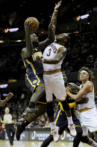Oct 19, 2013; Cleveland, OH, USA; Indiana Pacers guard Lance Stephenson (1) and Cleveland Cavaliers guard Dion Waiters (3) during the game at Quicken Loans Arena. The Pacers beat the Cavaliers 102-79. Mandatory Credit: Ken Blaze-USA TODAY Sports