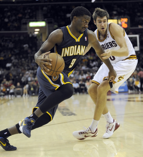 Oct 19, 2013; Cleveland, OH, USA; Indiana Pacers forward Solomon Hill (9) and Cleveland Cavaliers guard Sergey Karasev (10) during the game at Quicken Loans Arena. The Pacers beat the Cavaliers 102-79. Mandatory Credit: Ken Blaze-USA TODAY Sports