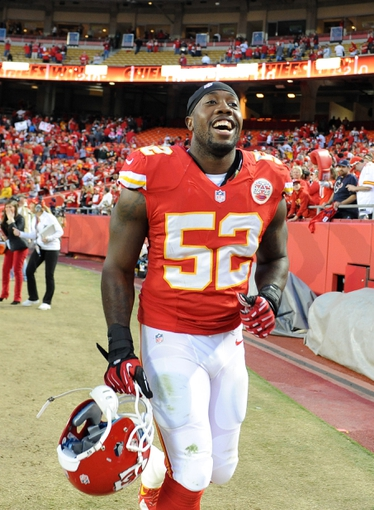 Oct 20, 2013; Kansas City, MO, USA; Kansas City Chiefs linebacker James-Michael Johnson (52) after the game against the Houston Texans at Arrowhead Stadium. The Chiefs won 17-16. Mandatory Credit: John Rieger-USA TODAY Sports