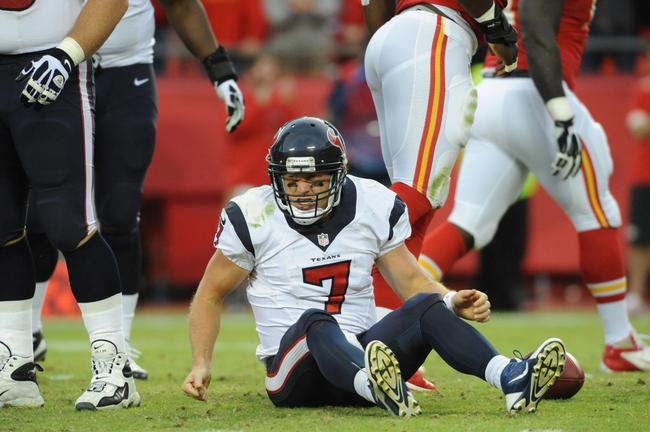 Oct 20, 2013; Kansas City, MO, USA; Houston Texans quarterback Case Keenum (7) reacts after being sacked during the second half of the game against the Kansas City Chiefs at Arrowhead Stadium. The Chiefs won 17-16. Mandatory Credit: Denny Medley-USA TODAY Sports