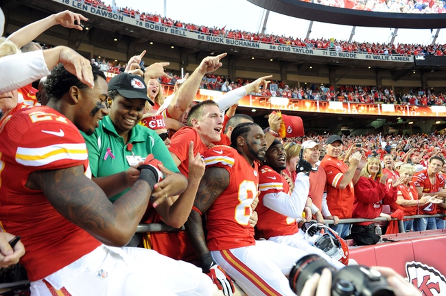 Oct 20, 2013; Kansas City, MO, USA; Kansas City Chiefs cornerback Sean Smith (27) and wide receivers Dwayne Bowe (82) and Donnie Avery (17) celebrate with fans after the game against the Houston Texans at Arrowhead Stadium. The Chiefs won 17-16. Mandatory Credit: John Rieger-USA TODAY Sports