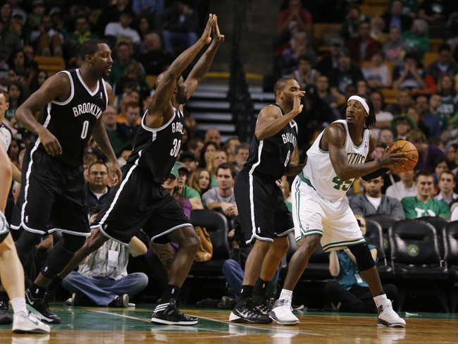 Oct 23, 2013; Boston, MA, USA; Boston Celtics small forward Gerald Wallace (45) looks for an opening against Brooklyn Nets shooting guard Alan Anderson (6) during the second quarter at TD Garden. Mandatory Credit: David Butler II-USA TODAY Sports