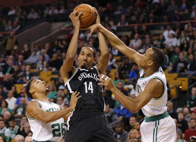 Oct 23, 2013; Boston, MA, USA; Brooklyn Nets point guard Shaun Livingston (14) works the ball against Boston Celtics point guard Avery Bradley (0) and point guard Phil Pressey (26) during the second quarter at TD Garden. Mandatory Credit: David Butler II-USA TODAY Sports
