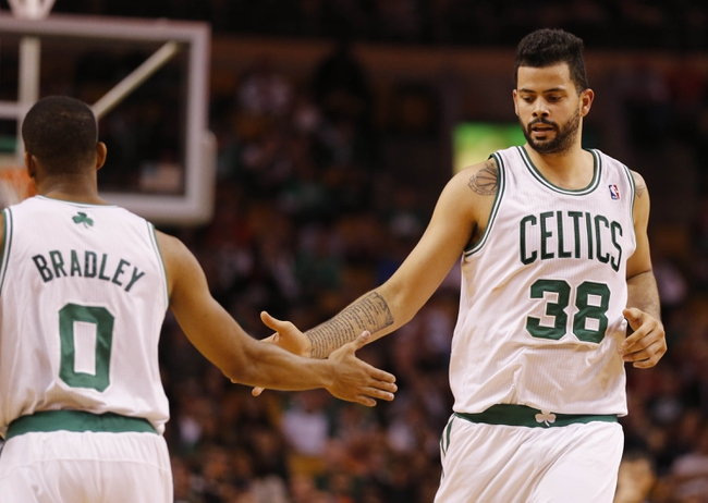 Oct 23, 2013; Boston, MA, USA; Boston Celtics center Vitor Faverani (38) and point guard Avery Bradley (0) react to a play against the Brooklyn Nets during the second quarter at TD Garden. Mandatory Credit: David Butler II-USA TODAY Sports