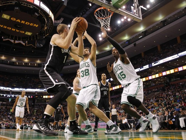 Oct 23, 2013; Boston, MA, USA; Boston Celtics center Vitor Faverani (38) and small forward Gerald Wallace (45) defend against Brooklyn Nets power forward Mason Plumlee (1) during the second quarter at TD Garden. Mandatory Credit: David Butler II-USA TODAY Sports