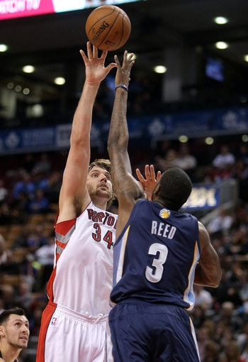 Oct 23, 2013; Toronto, Ontario, CAN; Toronto Raptors center Aaron Gray (34) shoots against the Memphis Grizzlies at Air Canada Centre. The Raptors beat the Grizzlies 108-72. Mandatory Credit: Tom Szczerbowski-USA TODAY Sports