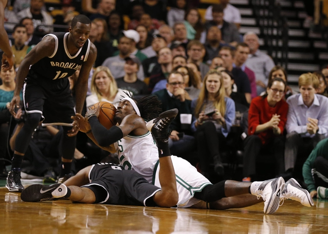 Oct 23, 2013; Boston, MA, USA; Boston Celtics small forward Gerald Wallace (45) works for the ball against Brooklyn Nets shooting guard Alan Anderson (6) during the second half at TD Garden. The Celtics defeated the Brooklyn Nets 101-97. Mandatory Credit: David Butler II-USA TODAY Sports