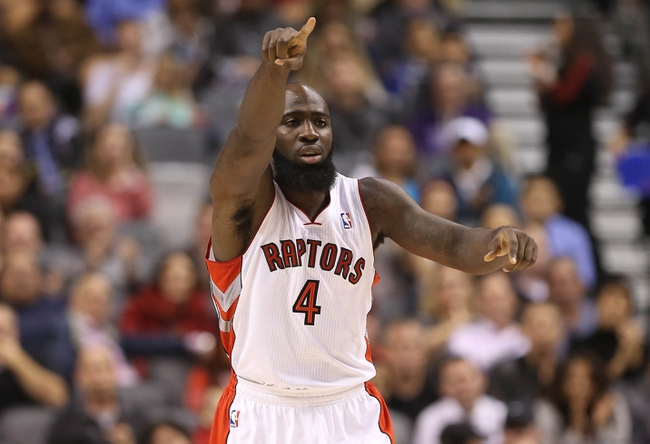 Oct 23, 2013; Toronto, Ontario, CAN; Toronto Raptors forward Quicny Acy (4) celebrates a basket against the Memphis Grizzlies at Air Canada Centre. The Raptors beat the Grizzlies 108-72. Mandatory Credit: Tom Szczerbowski-USA TODAY Sports
